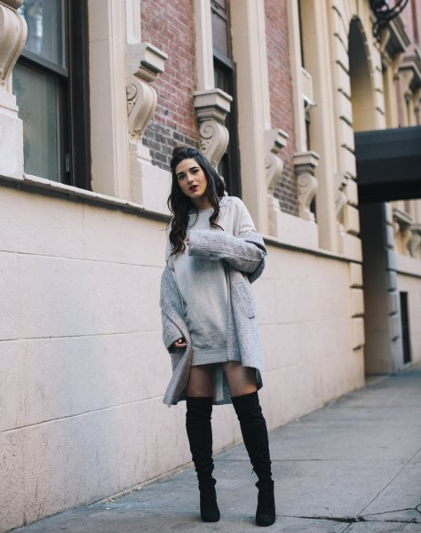 gray dress with a long wool coat and over the knee boots