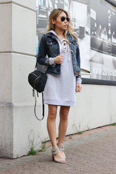 gray sweatshirt dress with hood and blue denim jacket