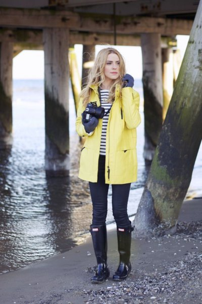 yellow rain jacket with black and white striped t-shirt and boots