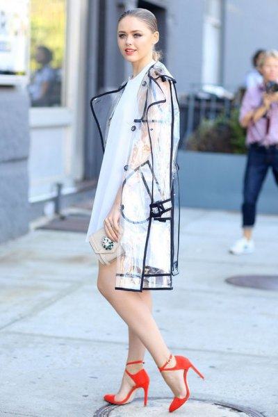 transparent rain jacket with black edges and white mini dress