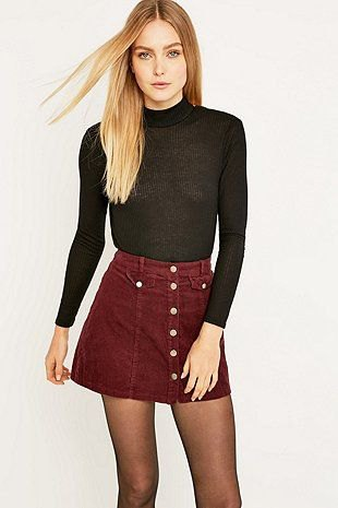 black mock neck sweater with auburn mini rat skirt with button placket