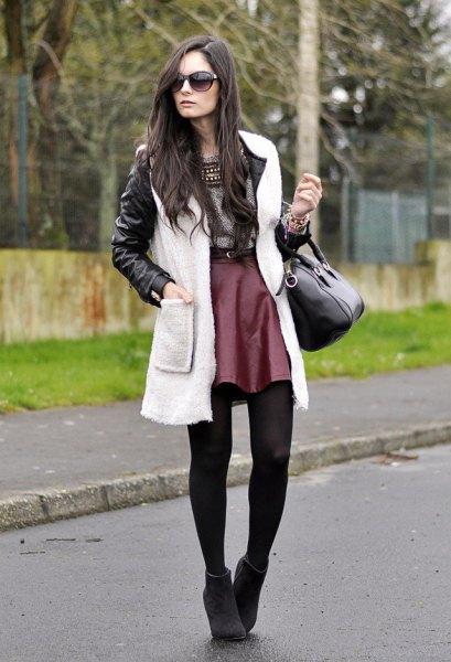 black leather jacket with white fleece vest and auburn silk skater skirt