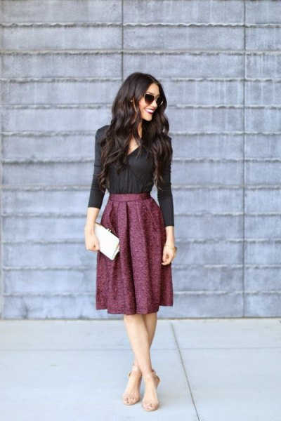 black shirt with buttons and midi pleated skirt made of wool