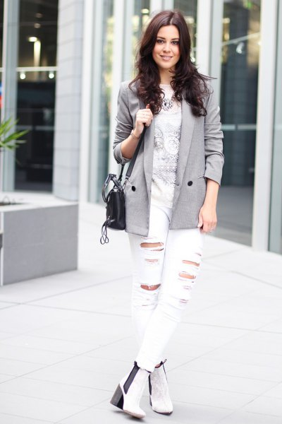 gray blazer with printed t-shirt and white jeans