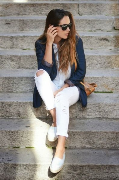 Dark blue denim blazer jacket with white skinny jeans and loafers