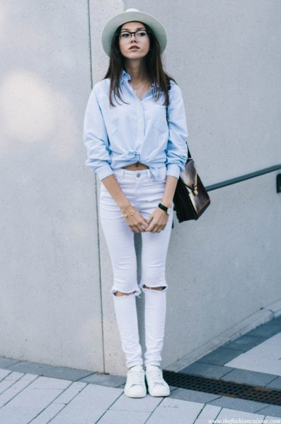 light blue knotted shirt with torn skinny jeans