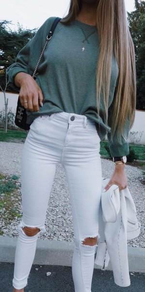 gray, chunky sweater with white, torn skinny jeans