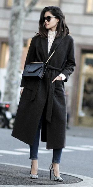 black woolen coat with gray knitted sweater with stand-up collar and ankle jeans