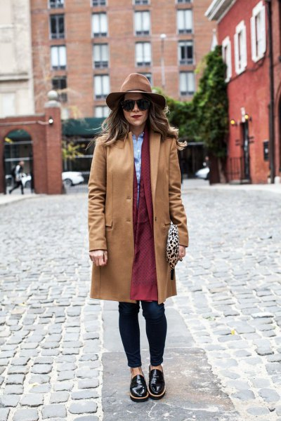 Camel hiking coat with brown longline coat dress and black leather shoes