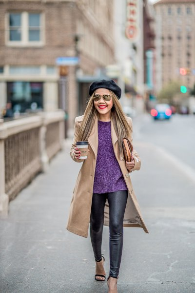 Blushing pink coat with dark blue sweater and black leather leggings