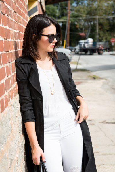 black longline coat with white tank top and matching skinny jeans