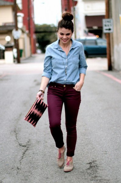 Light blue shirt with buttons and maroon slim fit jeans