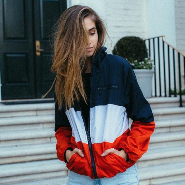 Dark blue white and red windbreaker with light blue boyfriend jeans