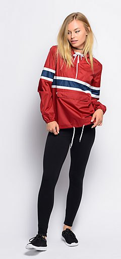 red sweater windbreaker with black leggings and sneakers