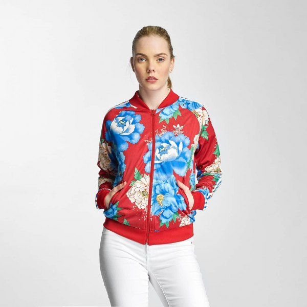 Sports jacket with red and blue floral print and white jeans