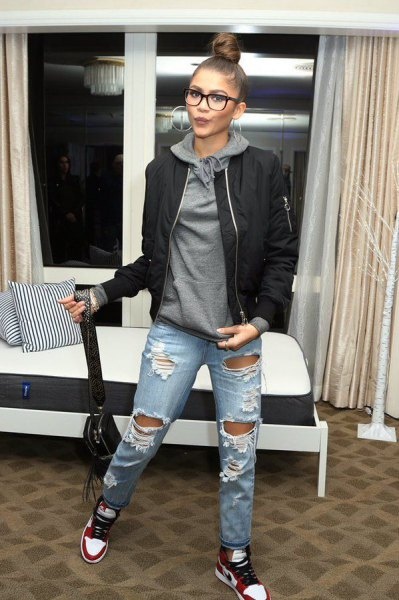 gray hoodie with black bomber jacket and torn boyfriend jeans