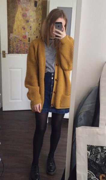 roughly ribbed cardigan with a striped t-shirt and denim skirt with a button placket
