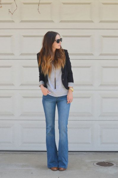 black blazer with gray tee and blue flare jeans