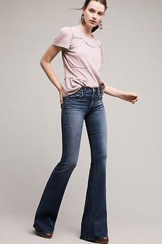 light pink t-shirt with dark blue low rise jeans