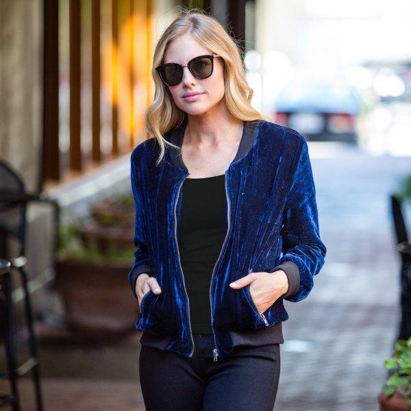 blue velvet bomber jacket with white tee and slim jeans