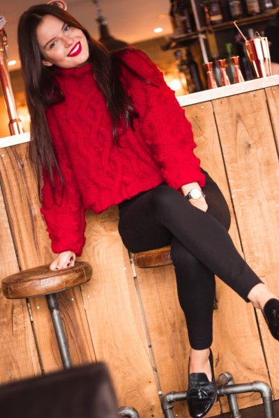 red knit sweater with suede with black slim fit jeans