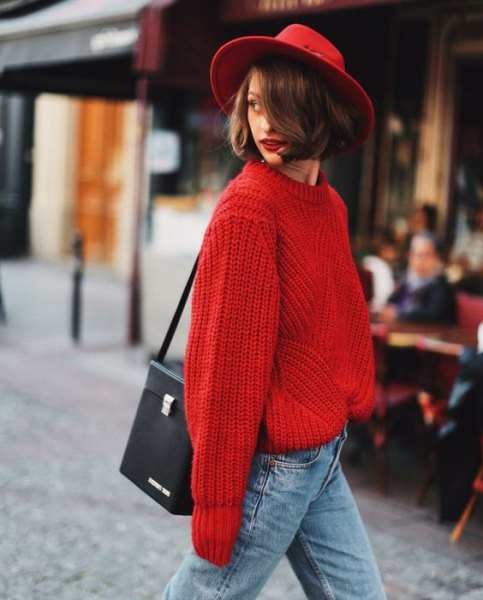red felt hat with chunky red sweater with light blue jeans