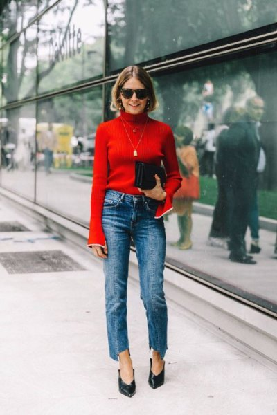 red sweater with back mock neck with blue cropped straight jeans