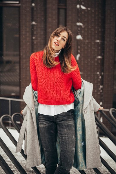 red ribbed sweater with white button shirt and gray wool coat