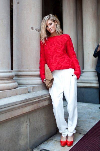 red knitted sweater with white casual fit pants