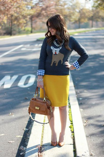 gray Christmas t-shirt with checkered shirt and yellow skirt