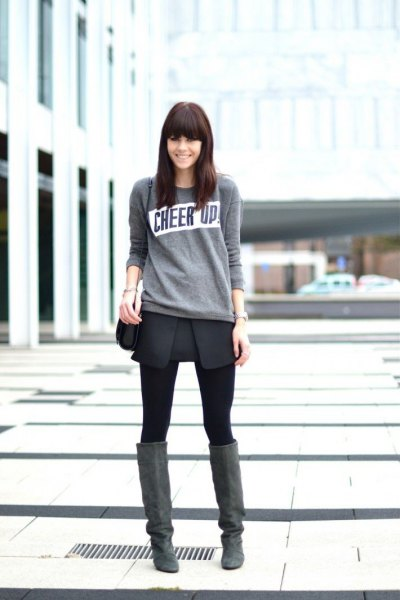 light gray sweater with black mini wrap skirt and over knee suede boots