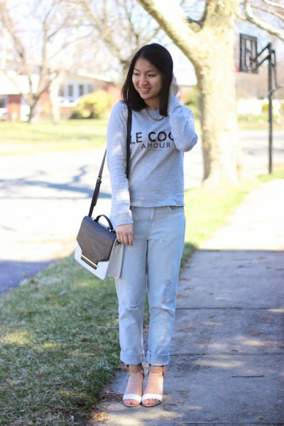 sweater with light blue cuffed boyfriend jeans and blush pink open toe short boots