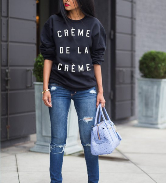 black chunky sweater with blue ripped slim fit jeans