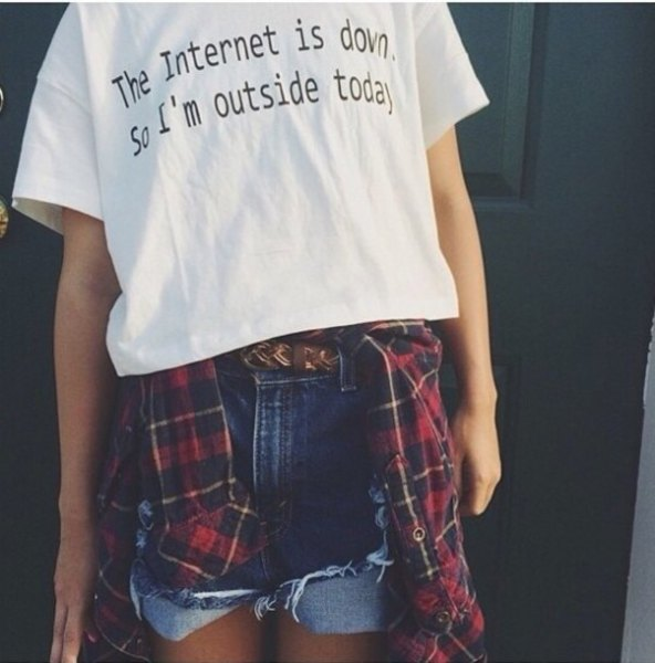 white print tee with blue denim shorts and red and black plaid boy's shirt
