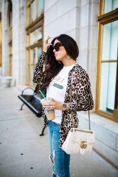 white tee with leopard print jacket and ripped blue jeans