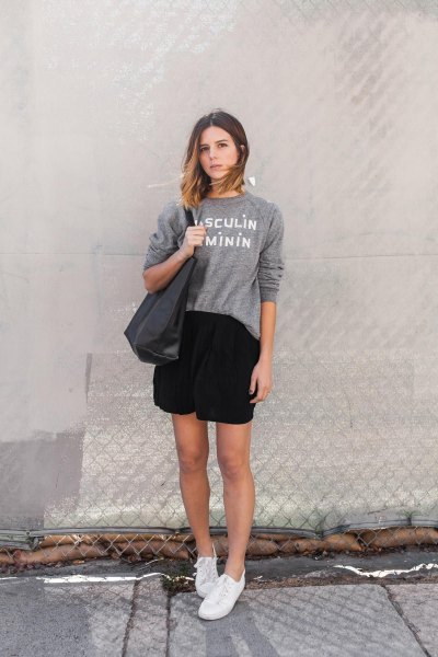 gray crew neck sweater with black mini wrap skirt