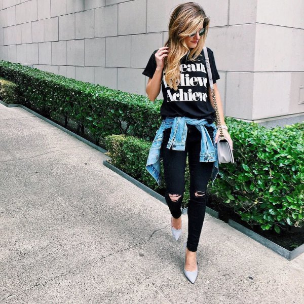 black print tee with ripped jeans and denim jacket tied around the waist