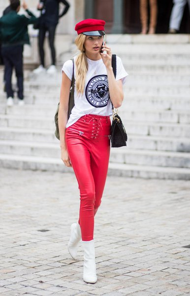 white cool graphic tee with red paint hat and matching leather clothes