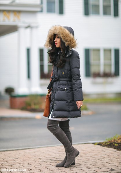 black long fur coat hooded down jacket with white tunic dress