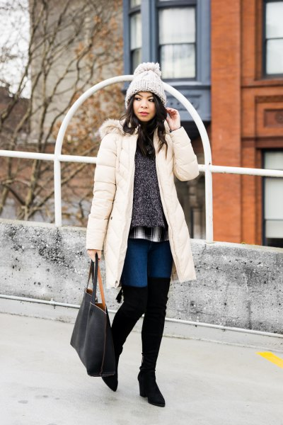 white long down coat with heather gray sweater and high thigh boots