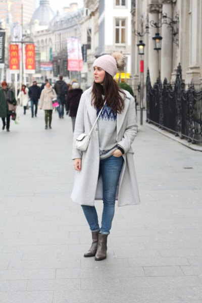 gray knitted hat and matching long winter coat and cuffed jeans