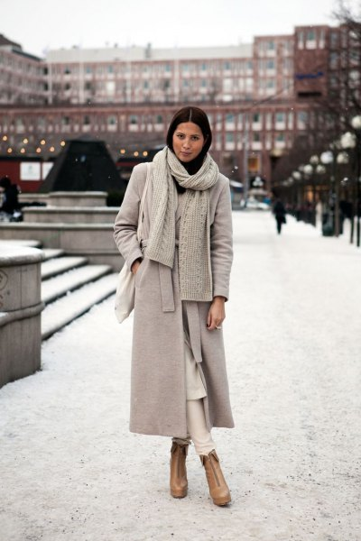 light gray maxi wool coat with knitted scarf and brown boots
