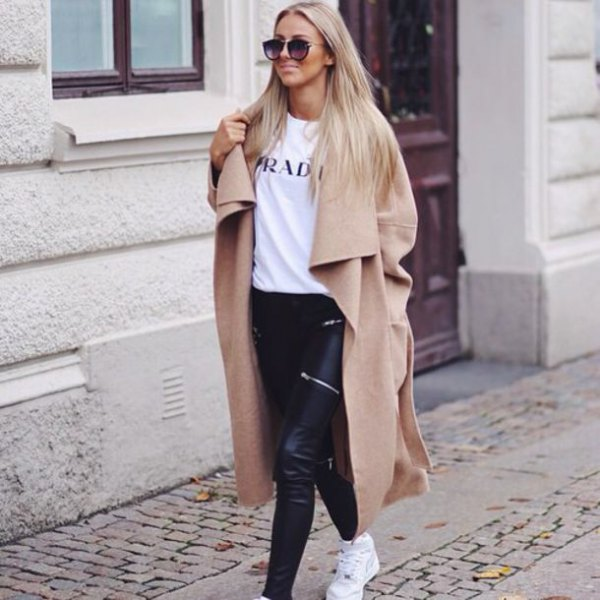 camel maxi length winter coat with white print tee and black leather pants