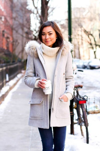 light gray long winter coat with white sweater in ribbed sweater