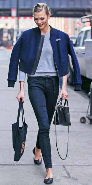 dark blue jacket with gray sweater and jeans with high waist