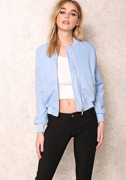 baby blue bomber jacket with white cropped tee and black slim fit jeans
