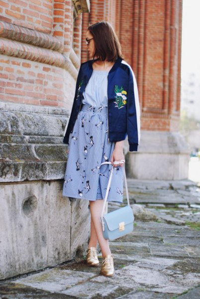 blue embroidered bomber jacket with light blue midi graphic skirt