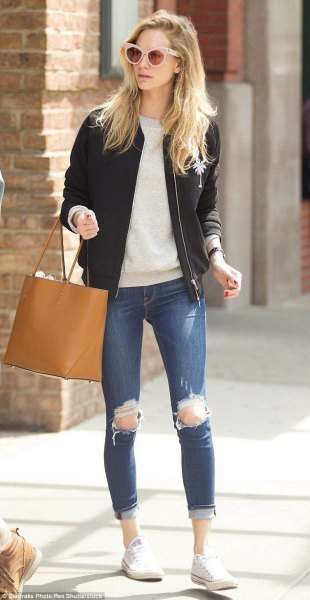 light gray sweater with crew neck with black leather fly jacket and ripped jeans