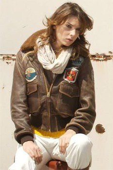 embroidered jacket in brown leather with white linen trousers