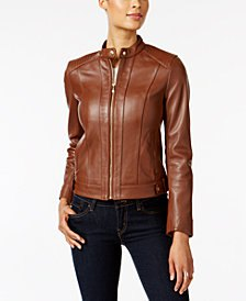 brown leather fly jacket with black skinny jeans